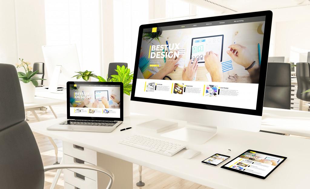 website on a laptop and desktop screen